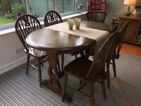 Lovely dark wood country kitchen style dining table and four matching chairs