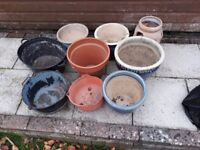 Assortment of planters and a tin bath
