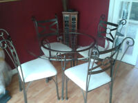 Quality glass dining table and 4 chairs