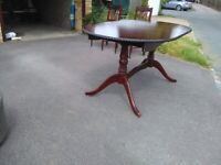 Extending oval dining table and 6 chairs