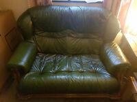 Antique leather sofa in green