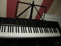Casio CTK1100 electric keyboard and stand