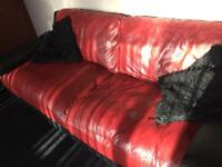 Real leather sofas in red/black with chrome trim