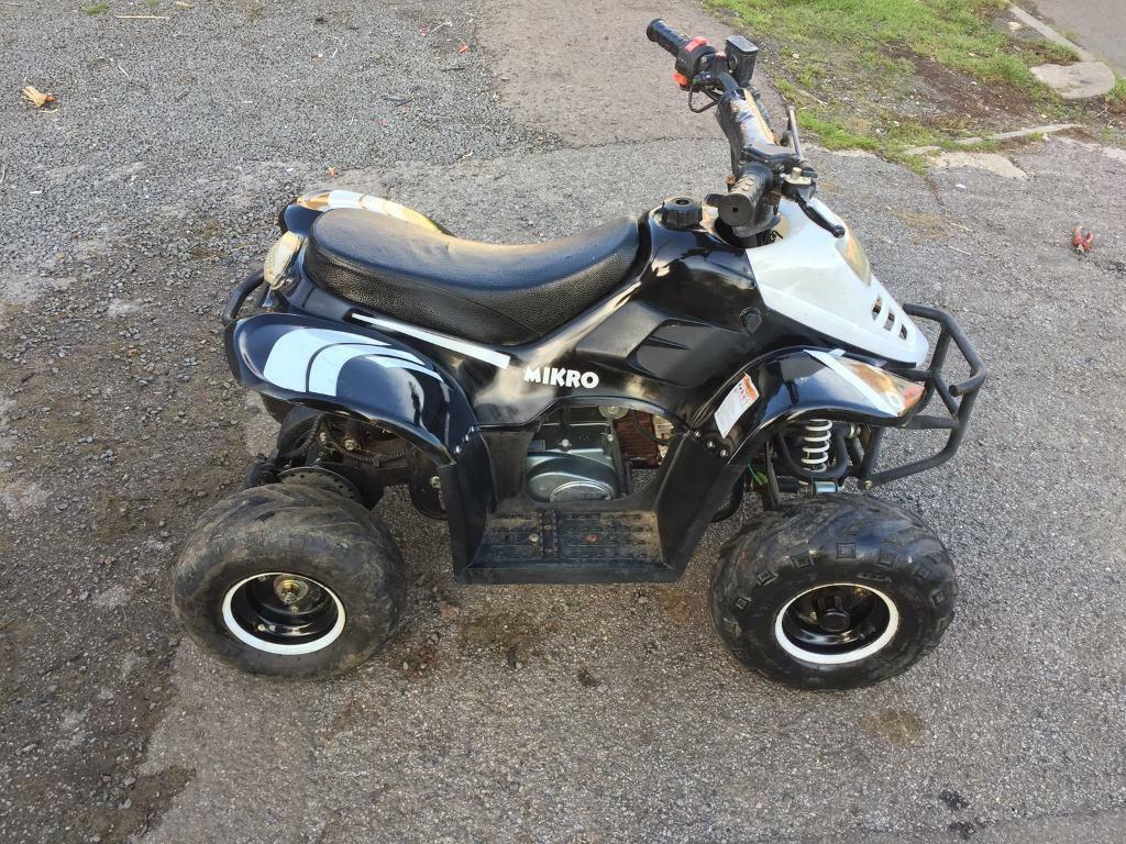 70cc kids quad bike in good working older £300 or swaps let me no what you have