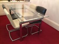 Glass 4 to 6 seater dining table and 4 chairs