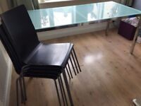 Glass and chrome table with 5 Chairs