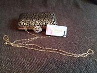 Faye London black & gold hard clutch bag/purse. Brand new.