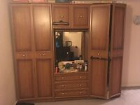 Two wooden wardrobes and dressing table unit
