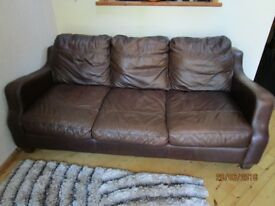 FREE 3 seater brown leather settee in good condition.