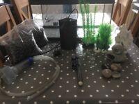 Aquarium with heater, pump, gravel and ornaments