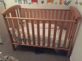 Free cot. Sturdy wooden cot with adjustable depth.