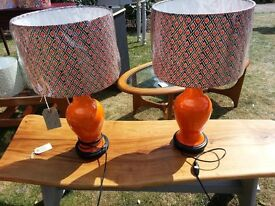 A pair of genuine 1960's retro orange table lamps with brand new hand made lamp shades