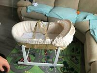 Rocking Moses basket, comes with blue and cream cover, hood part missing a washer to keep hood up