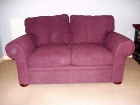 Two seater sofa in purple cord