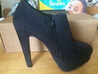 Brand new black high heels
