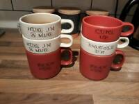 Set of slogan stackable mugs