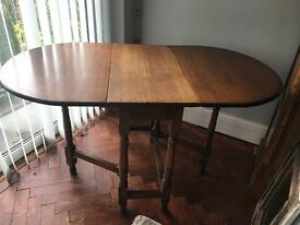 Drop leaf solid wood table