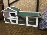 Brand new rabbit hutch with bottom run and rain cover