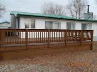 Fully furnished year round cottage with deck and garage.