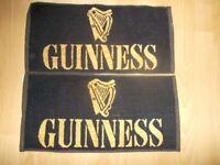 2 Guinness black/gold bar towels. Unused.