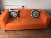 Orange faux leather sofa