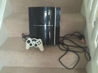 PlayStation 3 with white controller & cables
