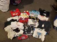Bundle of newborn baby clothes