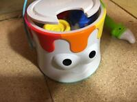 Never used fisher price paint pot toy