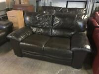 2 dark brown leather 2 seater sofas