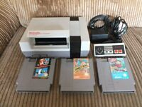 Nintendo NES console with a few games.