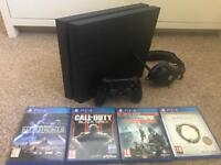 PS4 + 4 Games + Downloaded Games + Headset