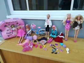 Barbie dolls, clothes, accessories and bicycle