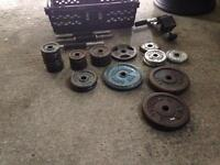 Metal weight plates around 34 kg + sit up bar and dumbbell bars 15 pound