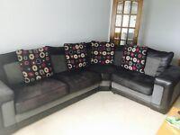 Black corner sofa with matching cuddle chair