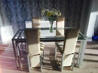 DFS glass table with four cream chairs