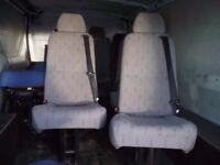 Van seats with built in seat belts.