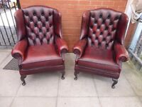 A Pair or Brown/Reddish Leather Chesterfield Queen Ann Chairs