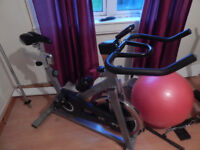 exercise sping cycle with 13kg flywheel as new with instructions
