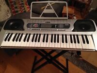 Acoustic solutions electronic keyboard and stand