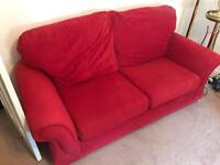 Red 2 seater sofa and matching arm chair