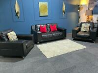 Stunning black leather suite. 2 seater sofa and 2 chairs