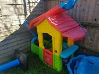 Plastic outdoor play house and slide