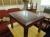 small dark wood glass topped occasional table.