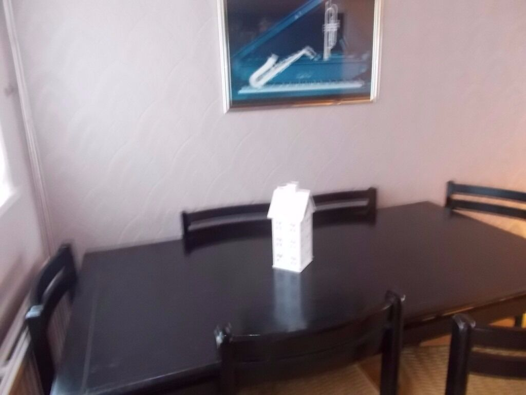 black ash table and 6 chairs very good quality and condition 166cmx83cm made in Denmark