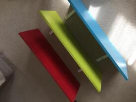 Three Ikea shelves (brightly coloured)