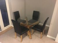 Round Glass and Oak Dining Table with 4 Chairs - quick sale required