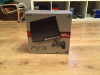 320gb PS3 slim with 14 games + accessories