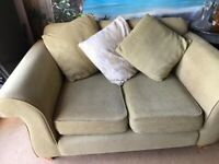 Two seater sofa in good condition - light green with cushions