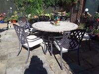 Large stone cast Mosaic table, 6 decorative metal chairs and seat pads