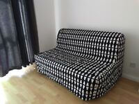 IKEA Futon Sofa Bed, LYCKSELE LÖVÅS two-seat in black and white Ebbarp print, retails for £210